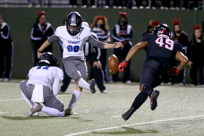 Mansfield Summit's Keaton Foster kicks the winning field goal with no time left on the clock Saturday night as the Rebels took on the Mansfield Summit Jaguars at Memorial Stadium in Wichita Falls.