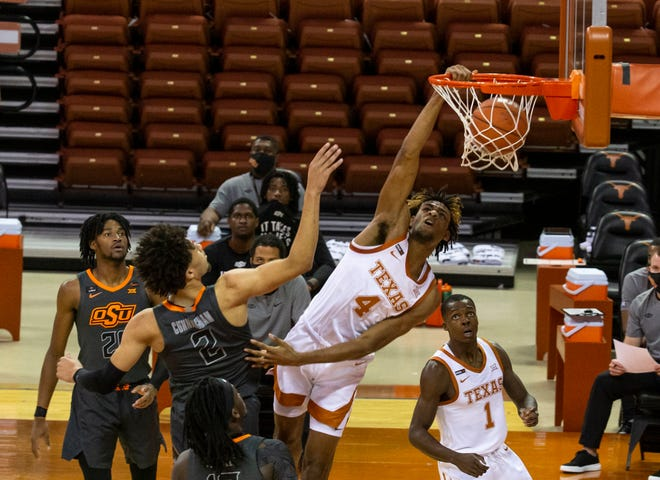 Texas' Greg Brown (4) makes a basket against Oklahoma during a basketball game at the University of Texas Frank Erwin Center, in Austin, Texas, on Dec. 20, 2020. Texas wins over Oklahoma 77-74.