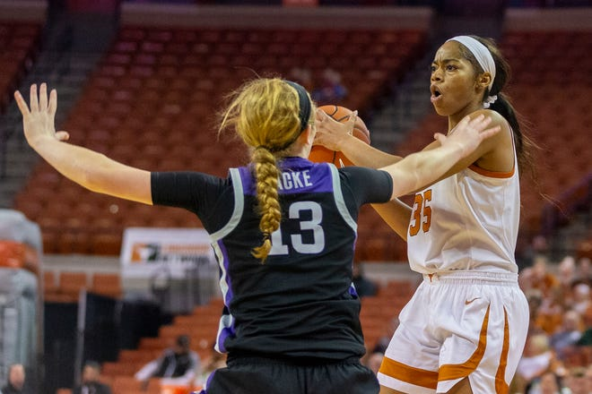 Texas center Charli Collier is defended by Kansas State's Laura Macke during last season's game in Austin.