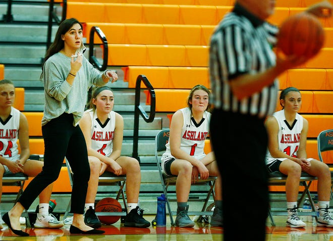 Ashland High girls basketball coach Renee Stimpert instructs her players from the sideline during a game against Loudonville High School on Dec. 10. Stimpert is in her first season coaching the Arrows.