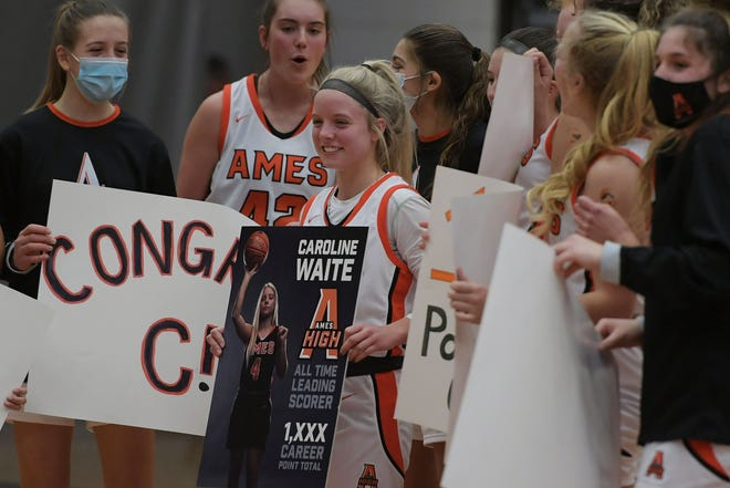 Ames' Caroline Waite gets congratulated by her teammates for becoming the Little Cyclones' all-time leading scorer during a short presentation after the first quarter of Saturday's girls' game between the Little Cyclones and Cedar Rapids Kennedy at Ames. Waite broke the former record of 1,231 points the night before with a 38-point outburst at Mason City. Those 38 points are also a school single-game scoring mark.