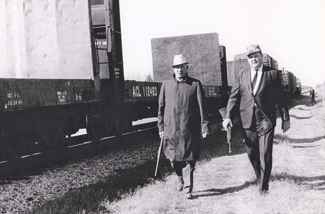 Aiken Sheriff Paul Grant (left) and Richmond County Sheriff E.R. Atkins patrol a rail yard after inmates broke out of the Augusta jail in 1968.