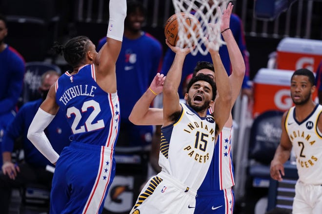 The Sixers' Matisse Thybulle contests the shot of the Pacers' Naz Mitrou-Long during Friday's preseason game.