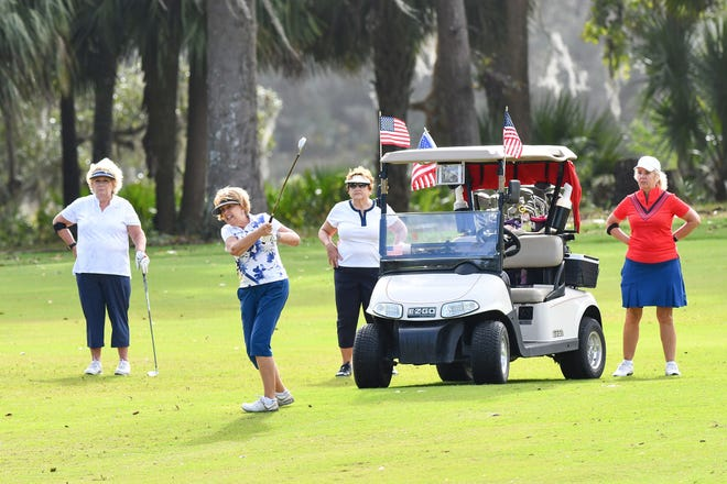 From left to right, Joann VanDett, Diane Bronzert, Paulette Matuch and Raani Kissinger shoot for the 17th green at the Lowcountry Veterans Day Golf Tournament at Crescent Pointe Golf Club.
