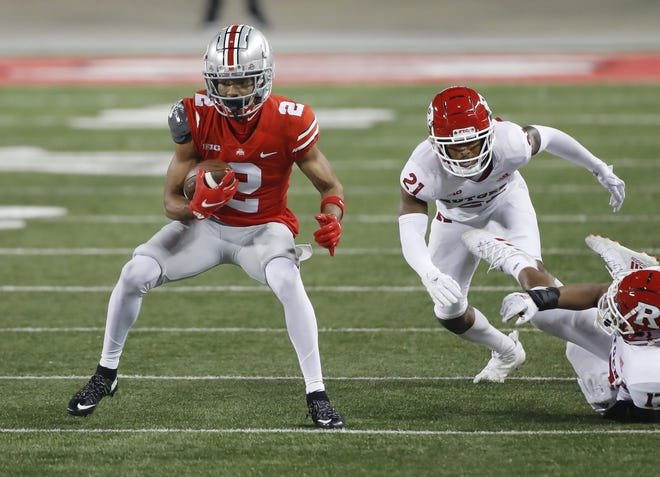 Ohio State wide receiver Chris Olave looks for running room during a game against Rutgers on Nov. 7.