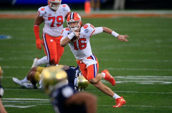 Clemson quarterback Trevor Lawrence runs the ball against Notre Dame on Saturday.