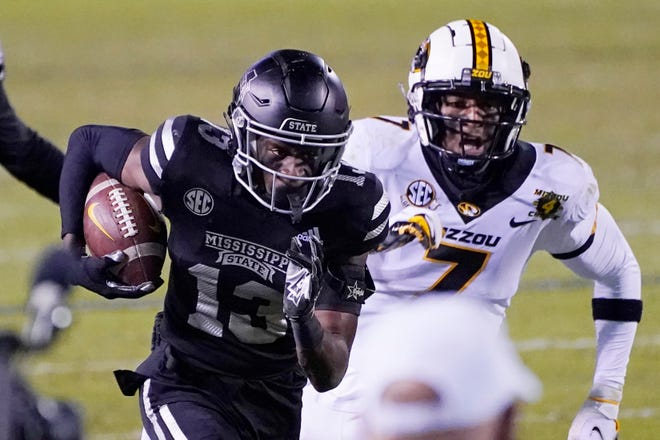 Mississippi State cornerback Emmanuel Forbes (13) sprints past Missouri wide receiver Damon Hazelton (7) on his way to returning a 29-yard touchdown interception during a game Saturday in Starkville, Miss.