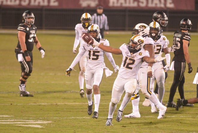 Missouri defensive back Shawn Robinson (12) reacts after an interception against Mississippi State during a game last Saturday in Starkville, Miss.