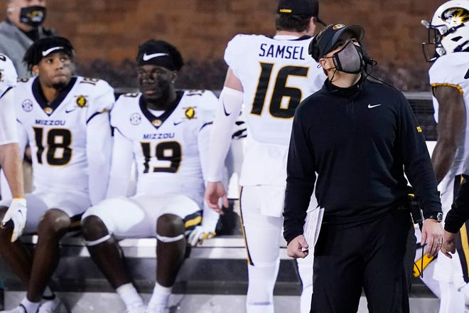 Missouri head football coach Eli Drinkwitz, right, looks at the scoreboard during a game against Mississippi State on Dec. 19 in Starkville, Miss.