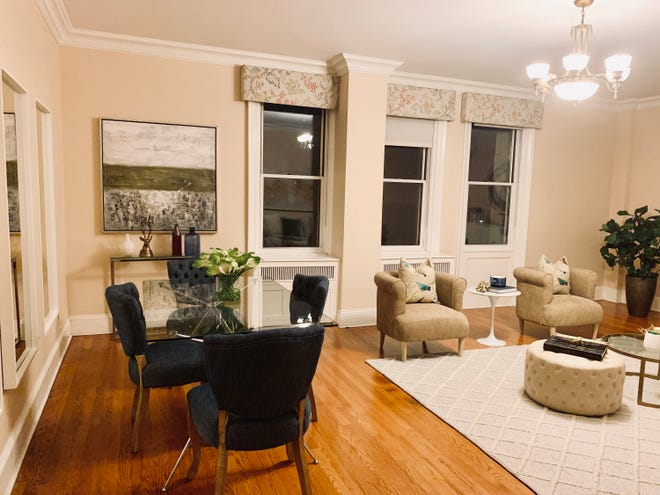 Flat valances add a touch of modernity to this living/dining space. (Design Recipes/TNS)