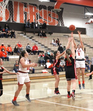 Meadowbrook's Kenli Norman (2) puts up a shot over a pair of Crooksville defenders during Saturday's MVL tussle at at Meadowbrook High School.