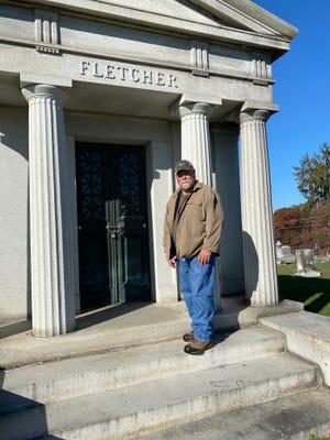 Caretaker Dave Woodring is shown at the mausoleum of Ambassador Henry Fletcher at Cedar Hill Cemetery.