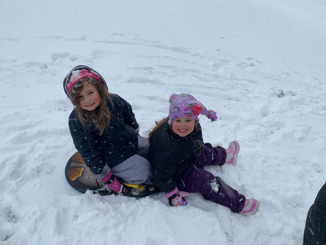 Sofia and Carmela Bartlinski had fun playing in the snow.