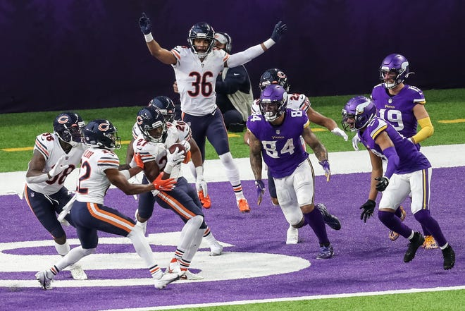 zDec 20, 2020; Minneapolis, Minnesota, USA; Chicago Bears defensive back Sherrick McManis (27) intercepts a pass in the end zone during the fourth quarter against the Minnesota Vikings at U.S. Bank Stadium. Mandatory Credit: Brace Hemmelgarn-USA TODAY Sports
