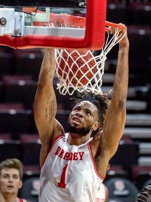 Bradley's Ari Boya dunks over the Miami defense in the second half Saturday, Dec. 19, 2020 at Carver Arena. The Braves defeated the Redhawks 69-68.