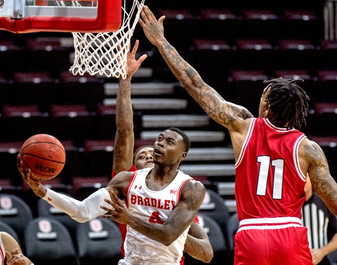 Bradley's Terry Nolan Jr. goes to the basket against Miami's James Beck in the second half Saturday, Dec. 19, 2020 at Carver Arena. The Braves defeated the Redhawks 69-68.