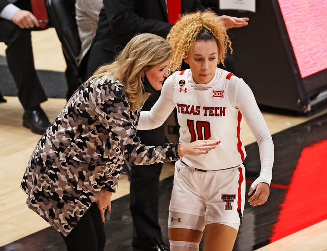 Texas Tech coach Krista Gerlich talks to Najé Murray (10) during the second half of a Big 12 Conference game Dec. 19, 2020 against TCU at United Supermarkets Arena.