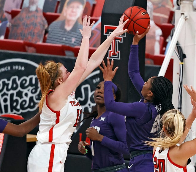 Texas Tech's Vivian Gray (12) blocks the shot by TCU's Lauren Heard (20) during the second half of a Big 12 Conference game Saturday at United Supermarkets Arena. Gray finished with her first double-double effort as a Lady Raider with 15 points and 10 rebounds, five assists, two blocks and two steals.
