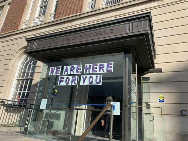 A message greets visitors at the entrance to the post office in Newport.