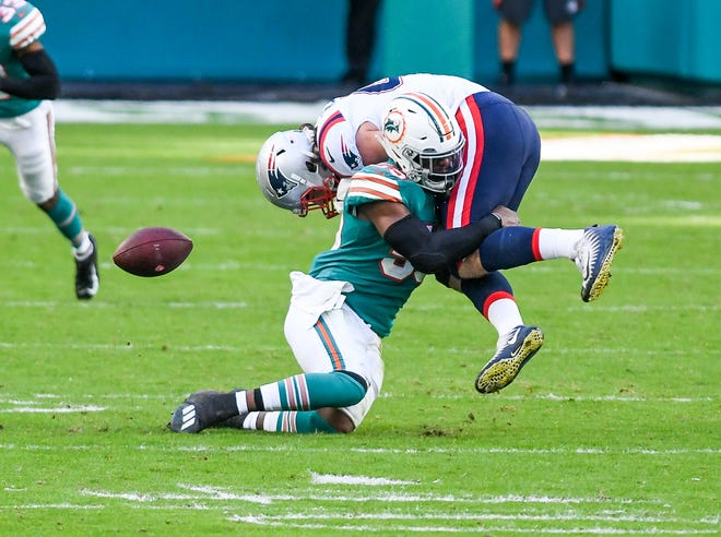 Miami Dolphins outside linebacker Jerome Baker (55) forces a fumble with a tackle in the fourth quarter at Hard Rock Stadium in Miami Gardens, December 20, 2020.