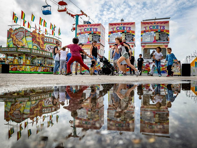 A few puddles remain after overnight showers at the South Florida Fair Friday in West Palm Beach in January. RICHARD GRAULICH / THE PALM BEACH POST