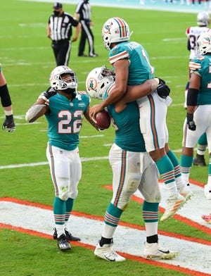 Miami Dolphins quarterback Tua Tagovailoa (1) celebrates a fourth quarter touchdown at Hard Rock Stadium in Miami Gardens, December 20, 2020.