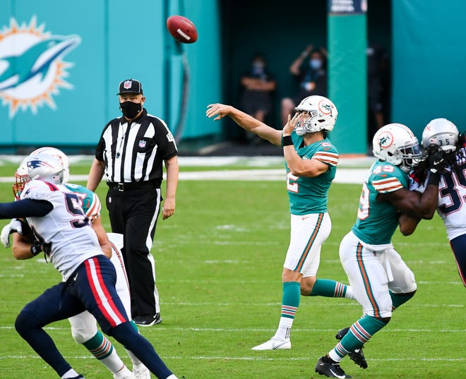 Dolphins punter Matt Haack throws a pass on a fake punt against the Patriots. The play was nullified by a penalty.