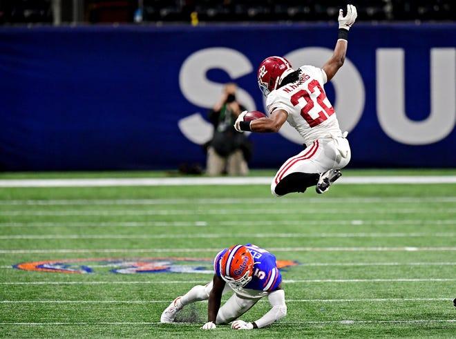 Alabama running back Najee Harris (22) jumps over Florida defensive back Kaiir Elam (5) during the fourth quarter of Saturday's SEC Championship game at Mercedes-Benz Stadium. [Adam Hagy-USA TODAY Sports]