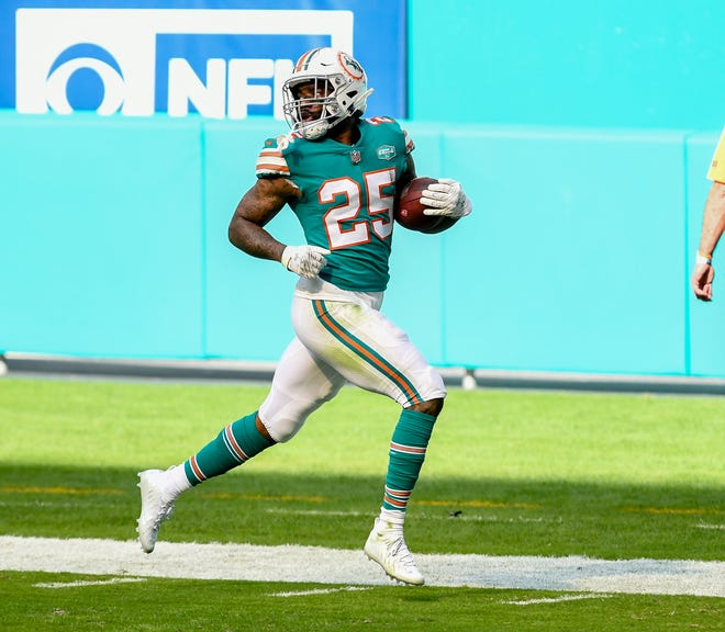 Dolphins cornerback Xavien Howard looks back as he returns a Cam Newton fumble 86 yards for a touchdown in the second quarter. The play was overturned on a replay review when it was determined the ball bounced off defensive lineman Christian Wilkins leg as he stepped out of bounds.