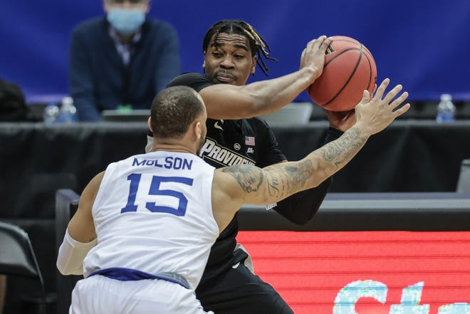 Friars guard A.J. Reeves shields the ball from Seton Hall guard Takal Molson (15) during the first half of Sunday's game at Prudential Center.