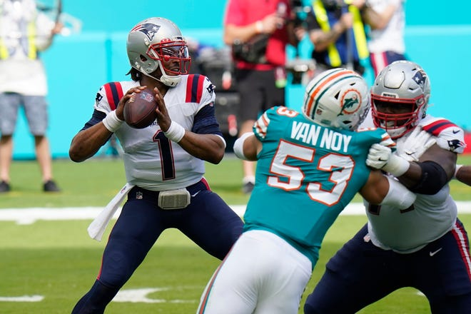 Patriots quarterback Cam Newton aims a pass during the first half of  Sunday against the Miami Dolphins.