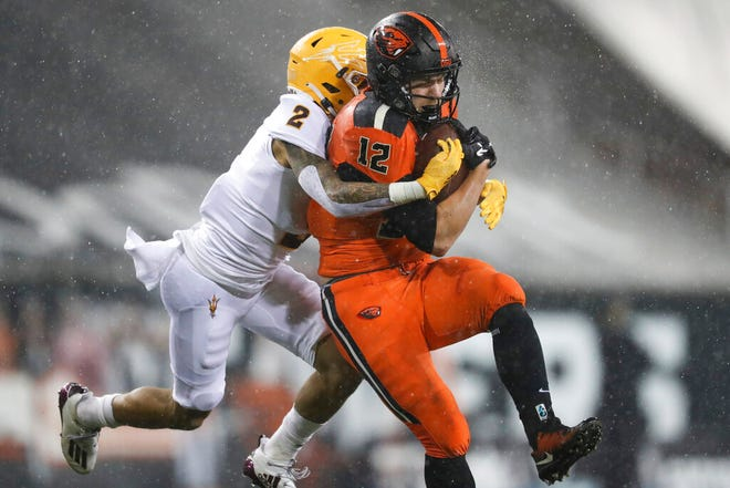 Oregon State inside linebacker Jack Colletto (12) is brought down by Arizona State defensive back DeAndre Pierce (2) during the first half of an NCAA college football game in Corvallis, Ore., Saturday, Dec. 19, 2020. (AP Photo/Amanda Loman)
