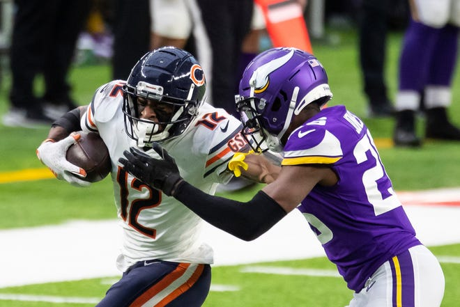 Chicago Bears wide receiver Allen Robinson (12) runs with the ball against Minnesota Vikings defensive back Chris Jones (26) in the fourth quarter during an NFL football game, Sunday, Dec. 20, 2020, in Minneapolis. The Bears defeated the Vikings 33-27. (AP Photo/David Berding)