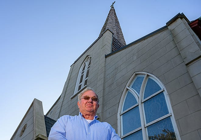 Barry Masters stands in front of the Trinity Parish Episcopal Church in St. Augustine on Friday, Dec. 18, 2020. Masters was once a bell-ringer in the historic Protestant church, the oldest in Florida.