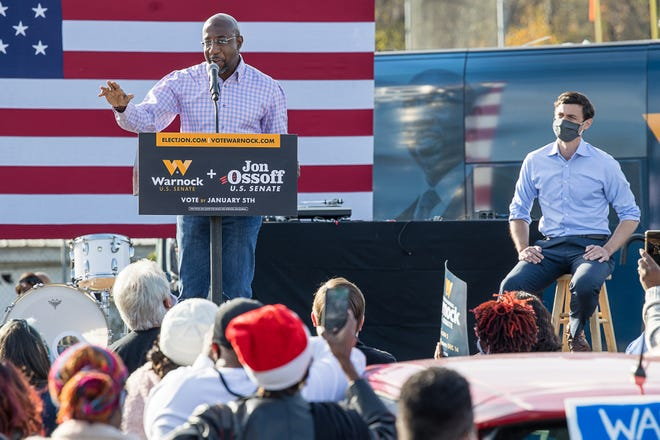U.S. Senate candidate Raphael Warnock shares the stage with fellow Democrat Jon Ossoff during a rally Saturday afternoon in Garden City.