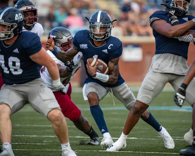 Georgia Southern senior quarterback Shai Werts looks for running room against Troy on Nov. 7 at Paulson Stadium in Statesboro. Georgia Southern won 20-13.