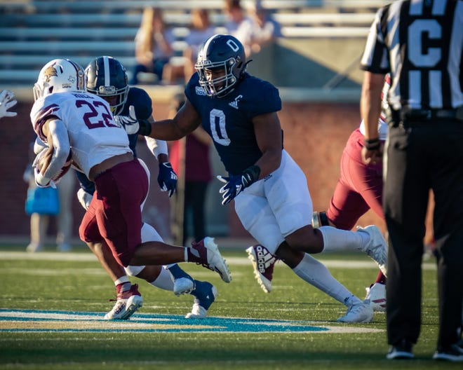 Georgia Southern defensive end Raymond Johnson III (0) goes to make the tackle against Texas State on Nov. 13 at Paulson Stadium in Statesboro. The Eagles won 40-38.