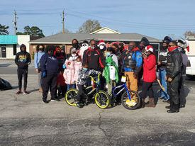 Members of Burn City Bike Club and Victor Taylor of Vision Forward recently held their annual Christmas with Santa Bike Run. The group delivered toys and gifts to more than 30 households in New Bern, Havelock, Vanceboro, Pollocksville and other surrounding areas. This is just one of the many contributions both organizations do to give back to their community. [Tina Adkins, Sun Journal]