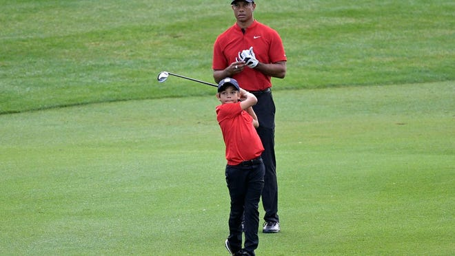 Tiger Woods watches his son Charlie's shot from the third fairway during Sunday's final round of the PNC Championship in Orlando, Florida.