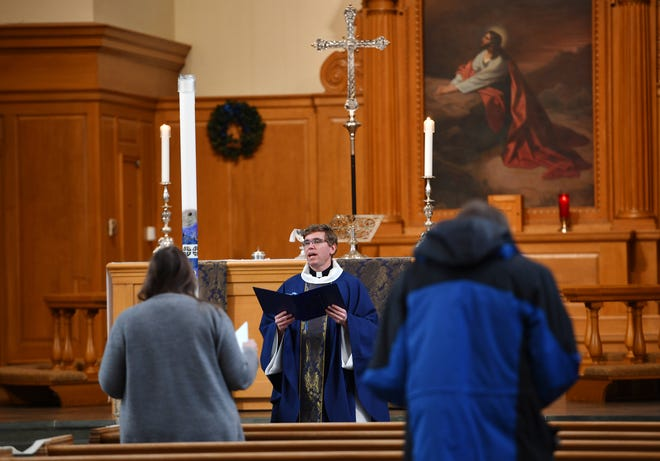 Pastor Nathan D. Pipho speaks during the service at Trinity Lutheran Church in Worcester, Sunday, Dec. 20, 2020.