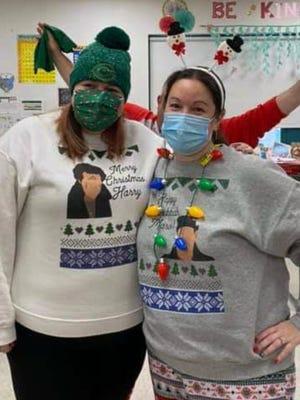 Shannon Reilly and Sarah Picariello show off their attire for the Clinton Elementary School ugly sweater competition Friday, Dec. 18. But, they were not ugly enough to win.