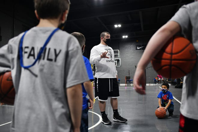 Ryan Brown, who played at Holy Name and WPI, gives back to community through a basketball skills/mentoring program called Go Hard or Stay home.