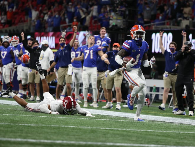 Florida's Kadarius Toney scores a touchdown against Alabama in the SEC Championship Game on Dec. 2020 at Mercedes-Benz Stadium in Atlanta. Toney started all 11 games and averaged 130.8 all-purpose yards per game touching the ball five different ways – receiving, rushing, passing and returning kicks and punts.