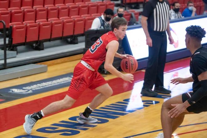 Colorado State University Pueblo's Tristan Hurdle dribbles passed a Colorado Mesa defender on December 19, 2020 at Massari Arena.