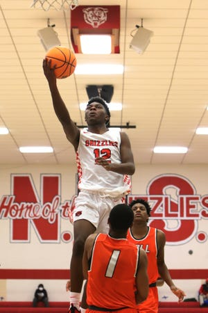 Northside's Dae Marion Savoy takes the shot over Little Rock Hall's Jordan Marsh in the third quarter, Thursday, Dec. 3, at Kaundart-Grizzly Field House.
