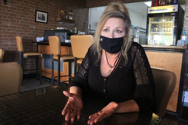 Cynthia Moore discusses Fort Smith's proposed 5% supplemental alcohol tax increase on Friday, Dec. 18, 2020, in her restaurant, Fifth Street Cafe. Moore said her restaurant lost more than half of its business and her bar, Old Town, lost 100% of its business during the onset of COVID-19.