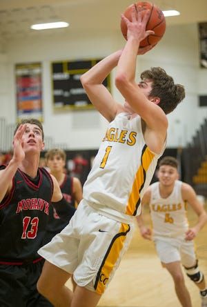 Colonel Crawford's Mason Studer pulls up for a mid-range jumper.