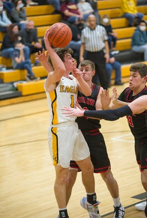 Colonel Crawford's Mason Studer passes over Mohawk's Trey Combs.