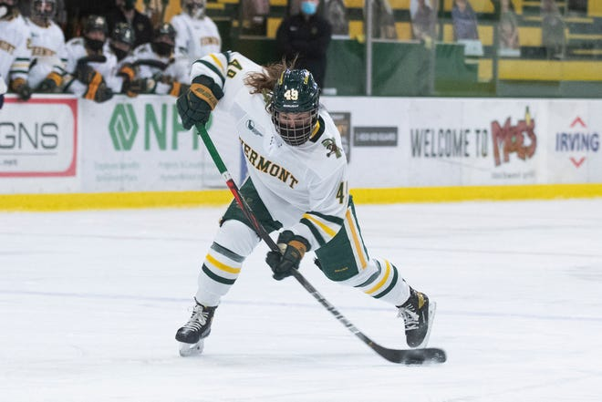 Vermont's Sara Levesque (49) shoots the puck during the women's hockey game between the New Hampshire Wildcats and the Vermont Catamounts at Gutterson Fieldhouse on Saturday night December 19, 2020 in Burlington, Vermont.