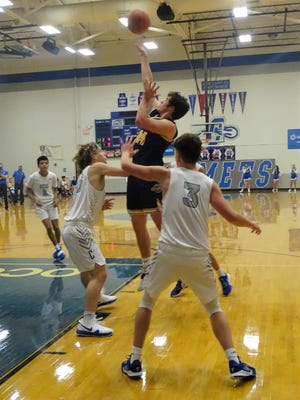 Lancaster junior Sam Finck shoots the ball over a Central Crossing defender during the Golden Gales 68-45 win Saturday night.
